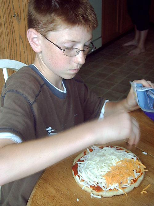Brandon making pizza